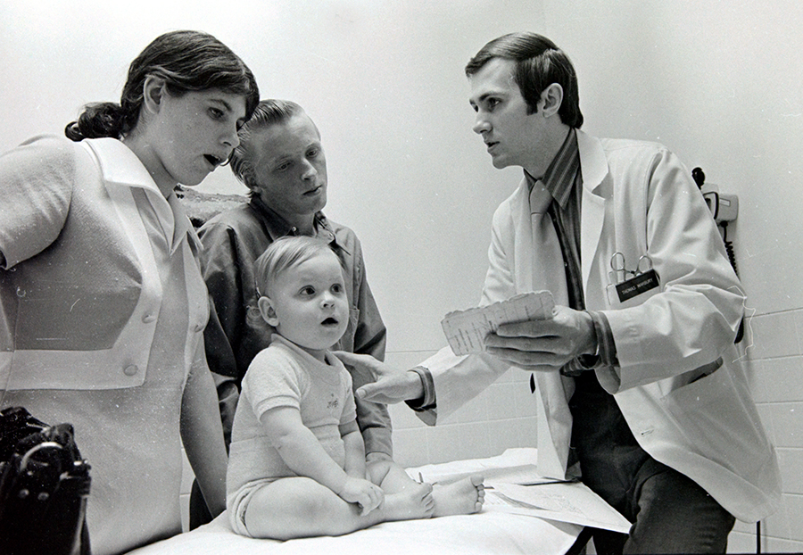 Dr. Thomas Marbury visits with a patient at the Memorial Downtown Clinic in 1974.