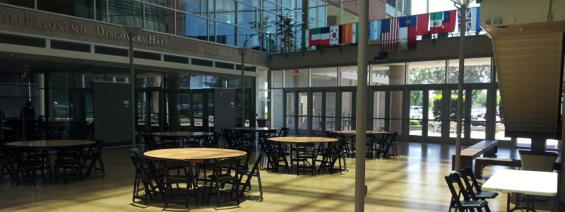 Picture of IMM Atrium with tables setup