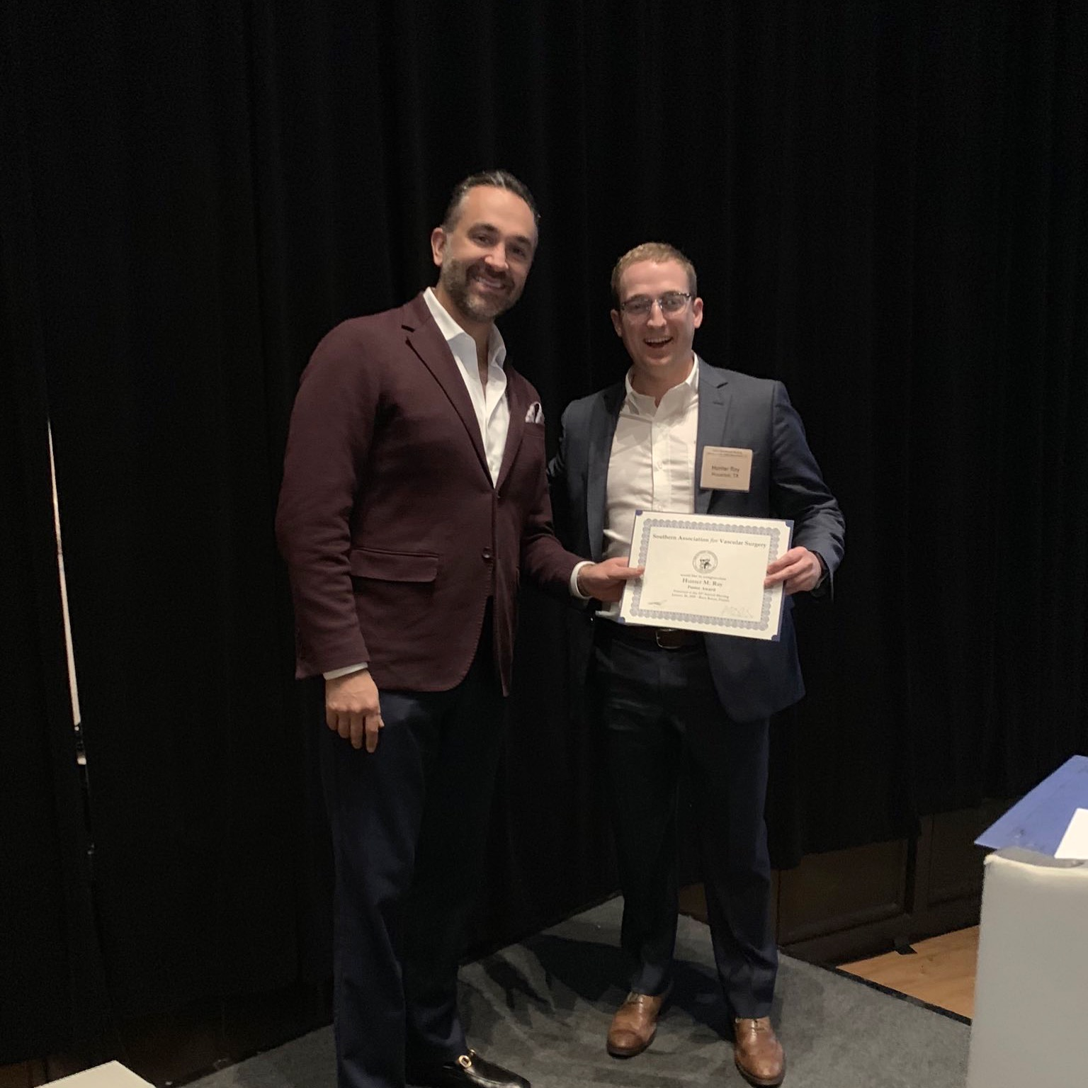 Dr. Ali Azizzadeh (right) with first place poster award winner Dr. Hunter Ray (left) at the 43rd Annual SAVS Meeting