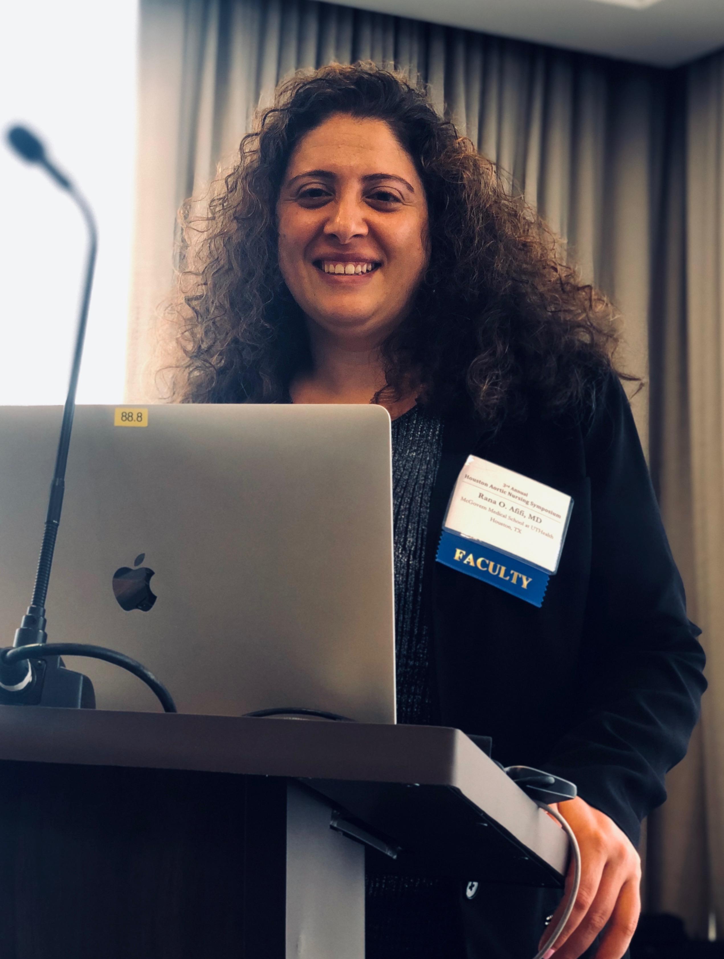 Dr. Rana afifi smiling at podium