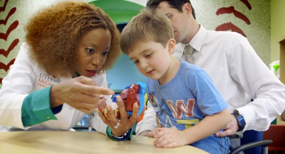 Doctor explaining heart to a child