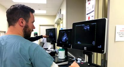 Doctor using an ultrasound machine