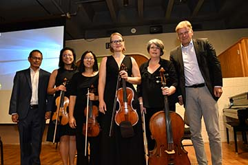 Dr. Henry Wang and members of the World Doctors Orchestra