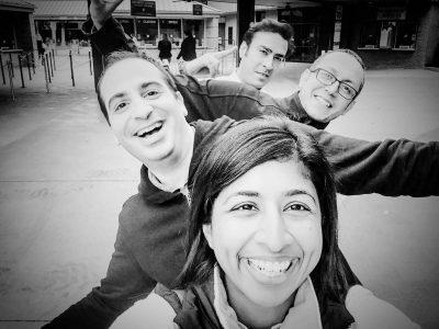 Image of Dr. Joyce Williams, Dr. Benjamin Tabibian, Dr. Ala Eddin Sagar, and Dr. Praveen Vijhani showing their smiles during a Pulmonary & Critical Care Medicine Fellowship Training Retreat with McGovern Medical School at UTHealth.