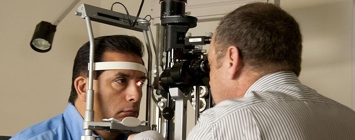 Dr. Feldman examines a patient