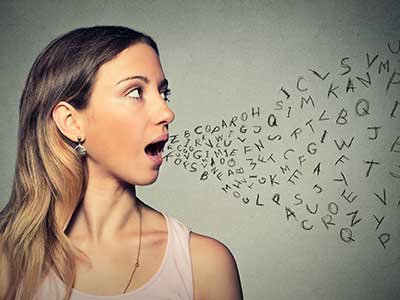 woman speaks alphabet