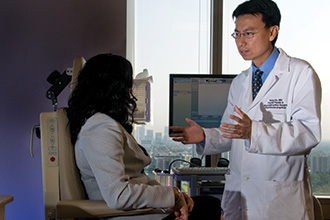 Tang Ho, MD, with Patients