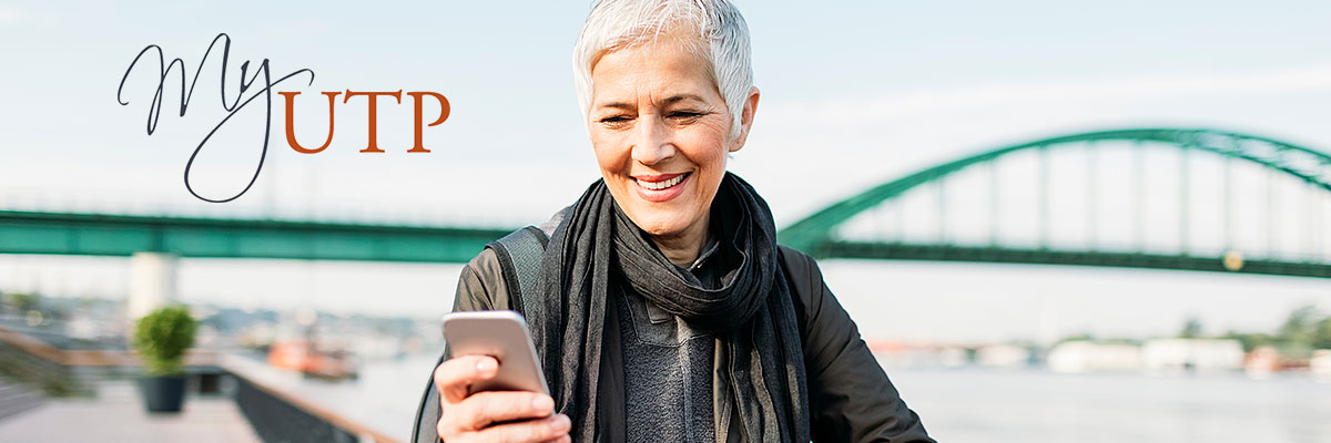 smiling woman looking at cellphone