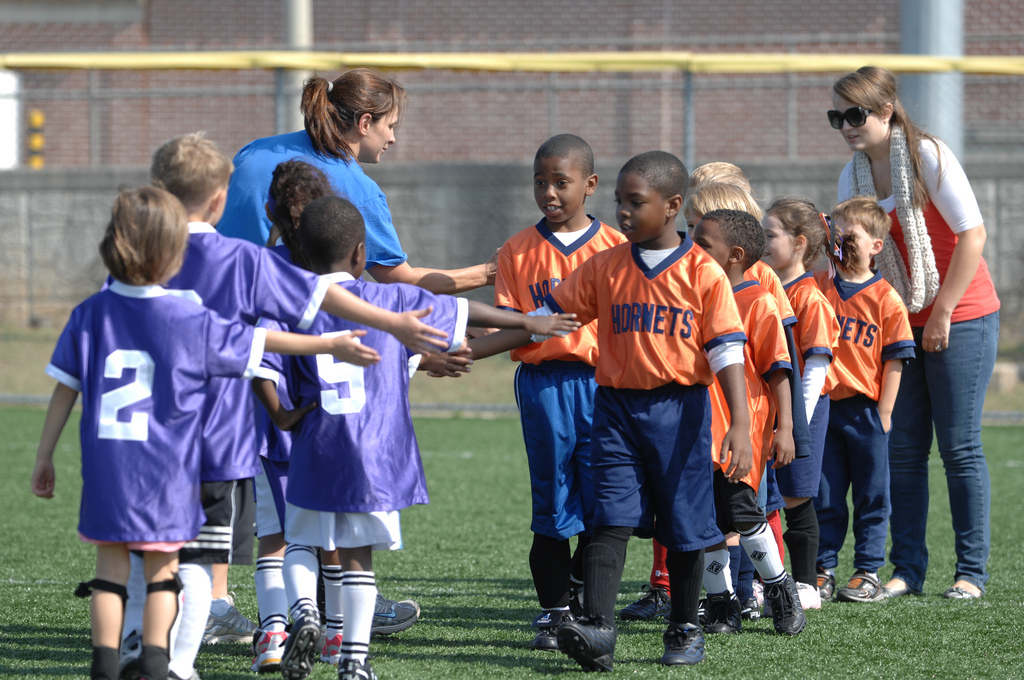 team work children field handshake