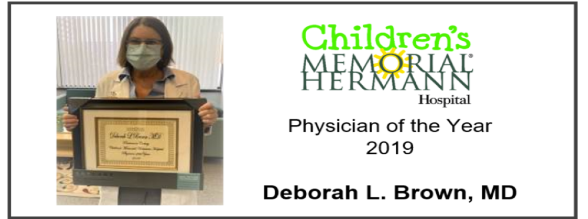 Dr. Brown holding her Physician of the Year 2019 award