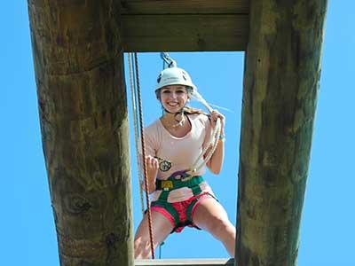 camper on rope swing