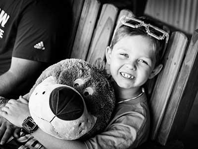 camper with stuffed bear