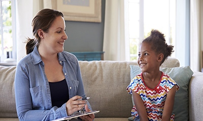 Young Girl Talking With Counselor At Home interview
