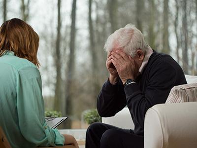 Image of broken down older man at psychotherapist's office