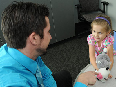 doctor playing with little girl