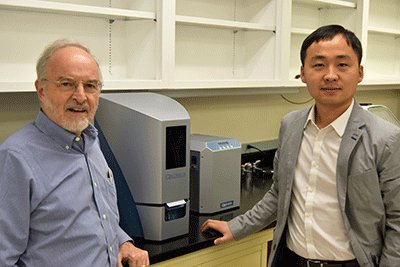 Rodney Kellems, Ph.D., left, and Wenbo Li, Ph.D., are looking for new treatments for disease at the molecular level.