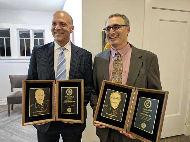 Mark Chassay, M.D., '92, (left) and Frank J. Domino, M.D., '88 (right) were the guests of honor at alumni events last weekend after being named Distinguished Alumnus Award winners.