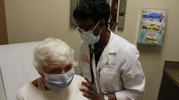 Dr. Carman Whiting sees a patient