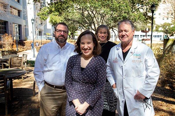 Alexis Shelly, her family, and Dr. Stephen Fletcher Pediatric Neurosurgeon