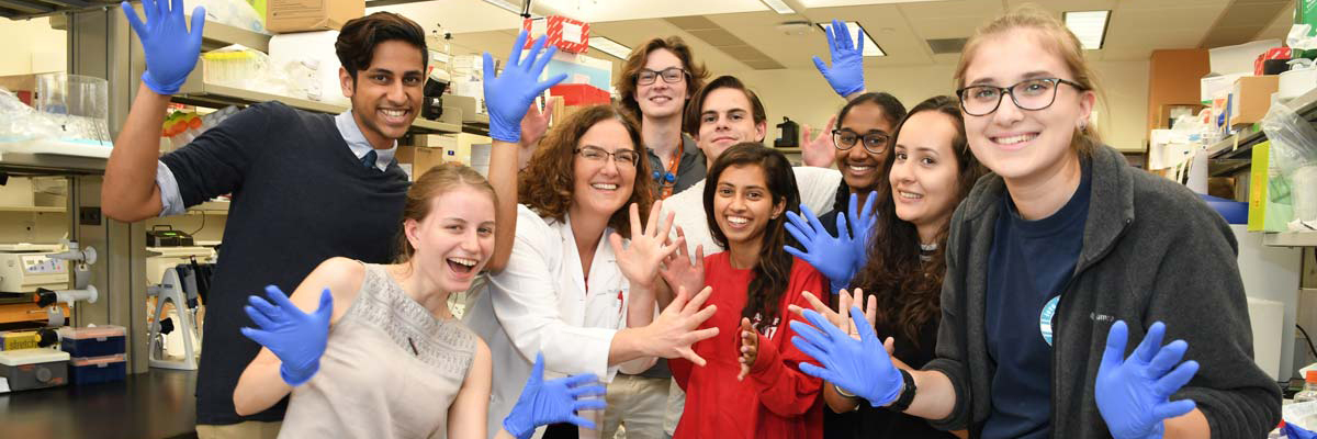 Dr.-Louise-McCullough-young-students-lr-cover image